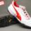Giày đá bóng Puma 2 màu đỏ trắng TF new gia re. Moi nhat