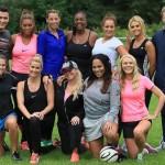 Chantelle Tagoe, vợ tiền đạo Emile Heskey (áo hồng đứng thứ hai từ trái sang) là người đưa ra ý tưởng tổ chức một trận đấu bóng từ thiện giữa các WAGs ở Anh để quyên góp tiền giúp đỡ trẻ em ở Nam Phi